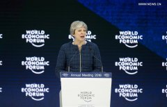 May says Britain to continue supporting free trade