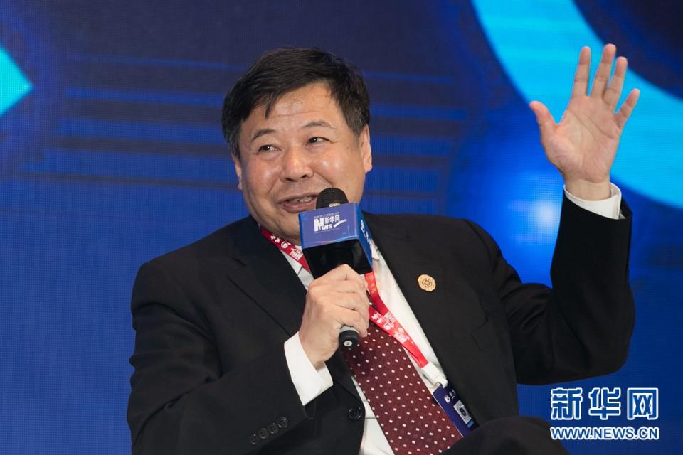 国务院参事、财政部原副部长朱光耀发言。新华网 郭小天摄