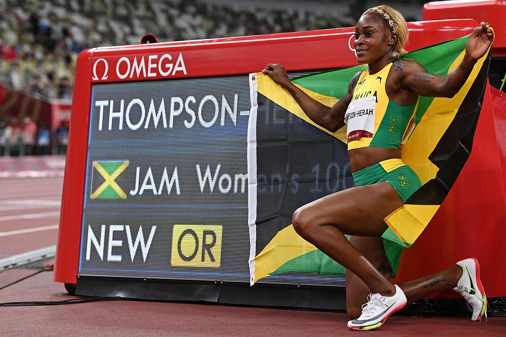 Elaine Thompson-Herah sets new Olympic record to win women's 100m
